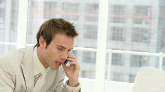 Frustrated businessman talking on phone Stock Footage