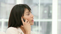 Charismatic young businesswoman on phone Stock Footage