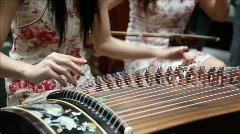 Playing chinese guzheng Stock Footage