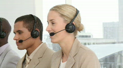 Multi-ethnic business people with headset on - stock footage