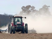 Farmer plowing his field with tractor Stock Footage