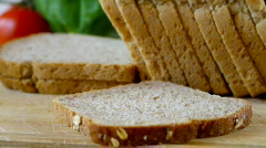 Close up of slice of bread being buttered Stock Footage
