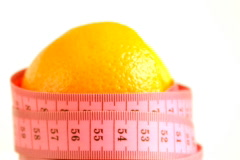 Orange with tape measure rotates , loopable - stock footage