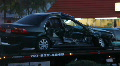 A Totaled Wrecked Car On A Flatbed Tow Truck At Night HD Footage