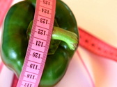 Stock Video Footage of Green pepper with tape measure rotates , loopable