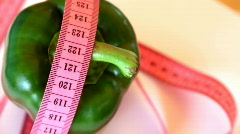Green pepper with tape measure rotates , loopable - stock footage