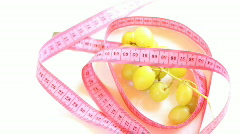 Grapes with tape measure rotates , loopable Stock Footage
