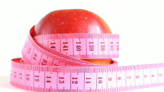 Red apple with tape measure rotates , loopable - stock footage