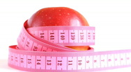 Red apple with tape measure rotates , loopable Stock Footage