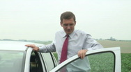 Stock Video Footage of Tired businessman beside his car