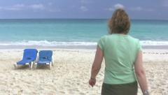 Mature Baby Boomer Woman Walking On A Cuban Beach Varadero Cuba Stock Footage