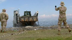 Sailors Offload Bull Dozer on Beach (HD) m Stock Footage