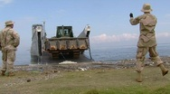 Sailors Offload Bull Dozer on Beach (HD) m Stock Footage