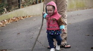 Stock Video Footage of toddler walking with a stick