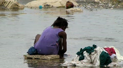 Girl Washing clothes in river (HD) c Stock Footage