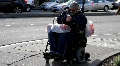 Handicapped man in wheelchair 2 HD Footage