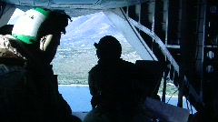Men in back of helo  (HD) - stock footage