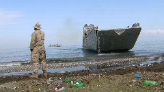 Stock Video Footage of Landing Craft Leaving Beach  (HD) m