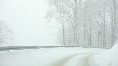 Car driving on Snow forest road - stock footage