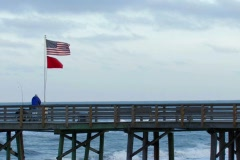 Fishing from Atlantic beach pier on windy evening Stock Footage