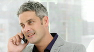 Lucky businessman talking on phone Stock Footage