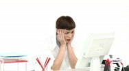 Stressed businesswoman working at a computer Stock Footage