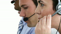 Concentrated business people working in a call-center - stock footage