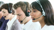 Stock Video Footage of Multi-ethnic business team working in a call-center