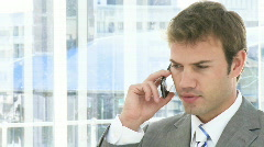 Self-assured business man on phone - stock footage