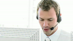 Serious businessman working with headset Stock Footage