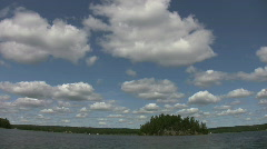 Island, clouds and boats. Mellow timelapse. - stock footage