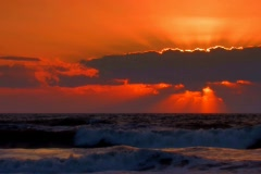 Firey Sunrise over Atlantic ocean surf Stock Footage