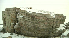 Complete Slow Pan of the Okotoks Glacial Erratic Big Rock in the Winter Stock Footage