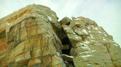 Camera Walks Around Strange Rocky Monolith in this 3D View in light Snow Storm Stock Footage