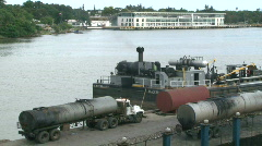 Stock Video Footage of Small, Fuel-Burning Ship Docked - Dominican Rep. - 04