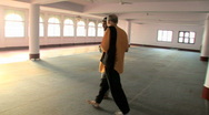 Stock Video Footage of 2 Men Walk and Talk inside Hassan Mosque in India