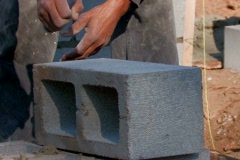 Mason cutting cement block  - stock footage