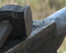 Working with metal at Smithy Stock Footage