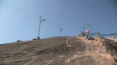 Woman Offered Chair for Walk up Mountain - stock footage
