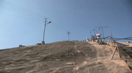 Stock Video Footage of Woman Offered Chair for Walk up Mountain