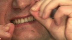 Flossing teeth Stock Footage
