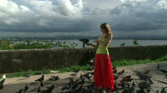 Girl with Birds in front of Ocean - Puerto Rico - 04 Stock Footage