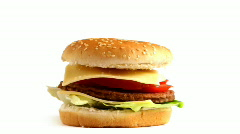Rotating Tasty hamburger on white background, loopable Stock Footage