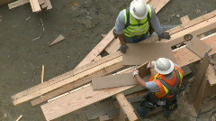 Construction workers take measurements - stock footage