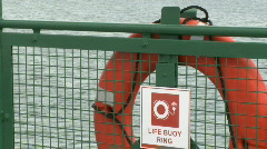 Life Buoy hangs on rail Stock Footage