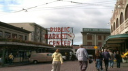 Stock Video Footage of Visitors enter Pike Place Market