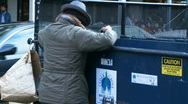 Man rummages for recyclables Stock Footage