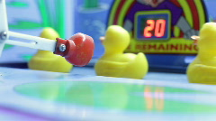 Plastic Ducks Hit by Boxing Glove - stock footage
