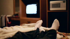 Feet in Bed watching TV Stock Footage