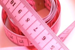 Rotating measuring tape , loopable - stock footage